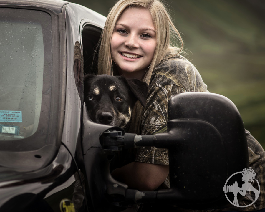 A closeup image of a girl with her dog.