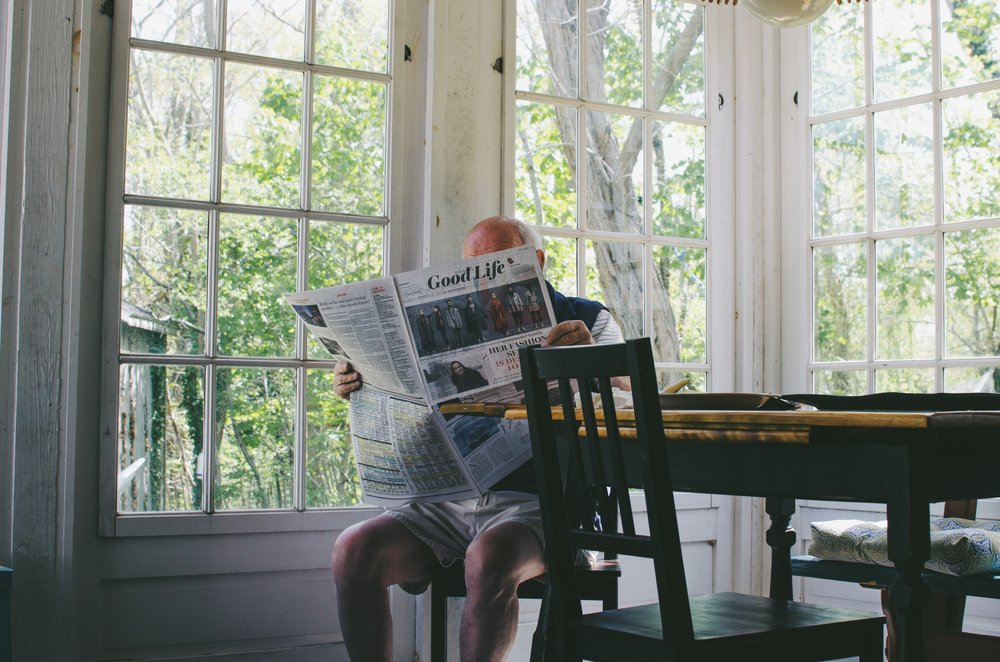 negative-space-old-man-reading-newspaper-morning-sam-wheeler.jpg