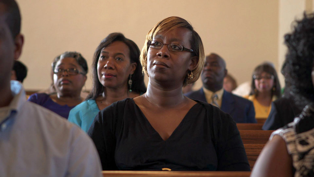 Woman_in_Westminster_Church_Listening_AmericanCreed_72dpi.jpg