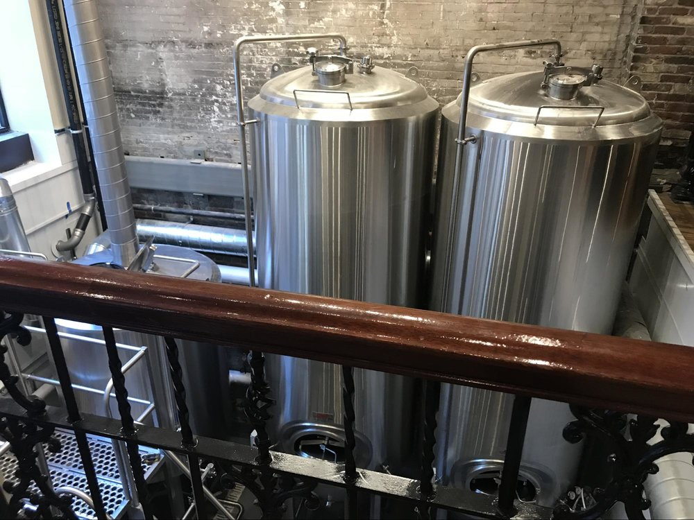 The brewery is visible to the pub's patrons, allowing them to see where their beer is sourced.