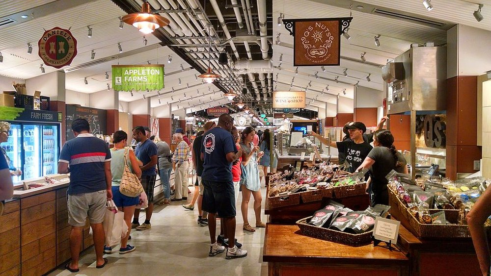Customers viewing the selection of goods and foods inside Boston Public Market