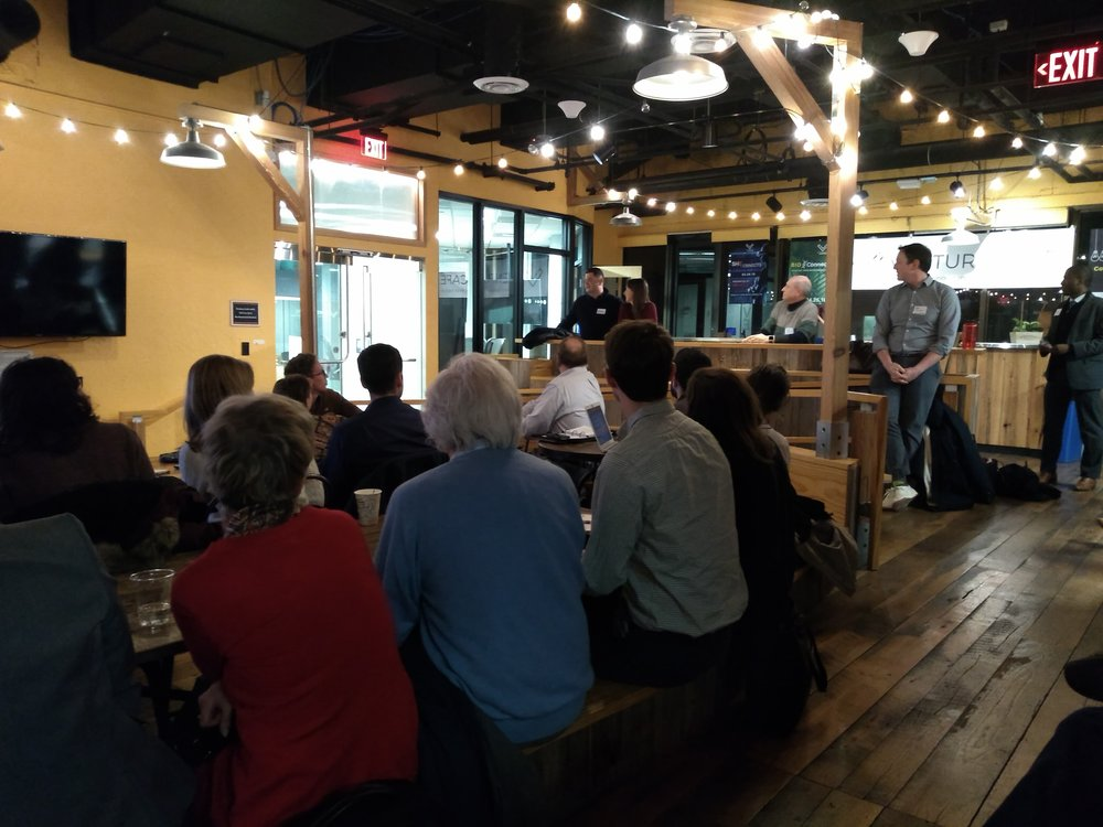 """The crowd at """"Put Your Money Where It Matters"""" learning about the difference between impact investing and Socially Responsible Investing (SRI)"""