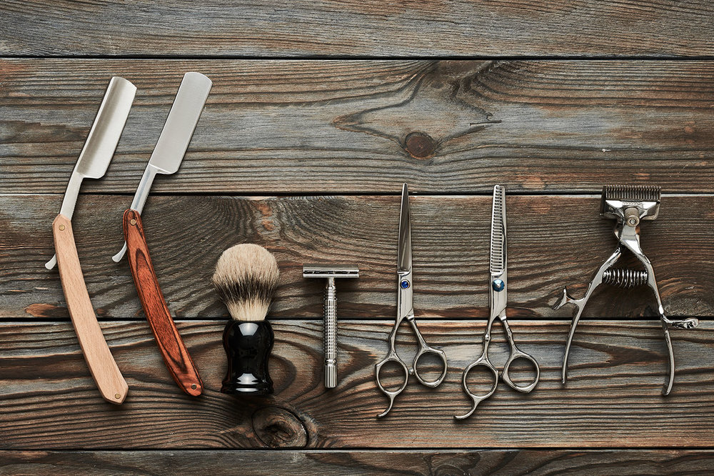 barber-shop-tools-on-wooden-background-PBHC3HU.jpg