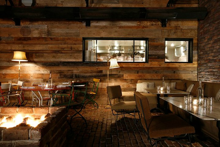 Communal tables and a cozy, comfortable atmosphere at  Gjelina  in Venice.