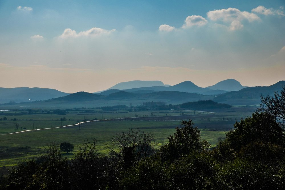 Kál Basin with Badacsony and other hills in background, Hungary |  ©John Szabo (published by Jacqui Small)