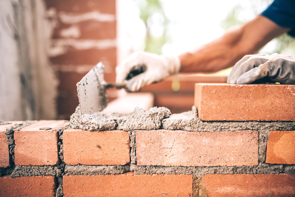 bigstock-Bricklayer-Worker-Installing-B-141056804.jpg