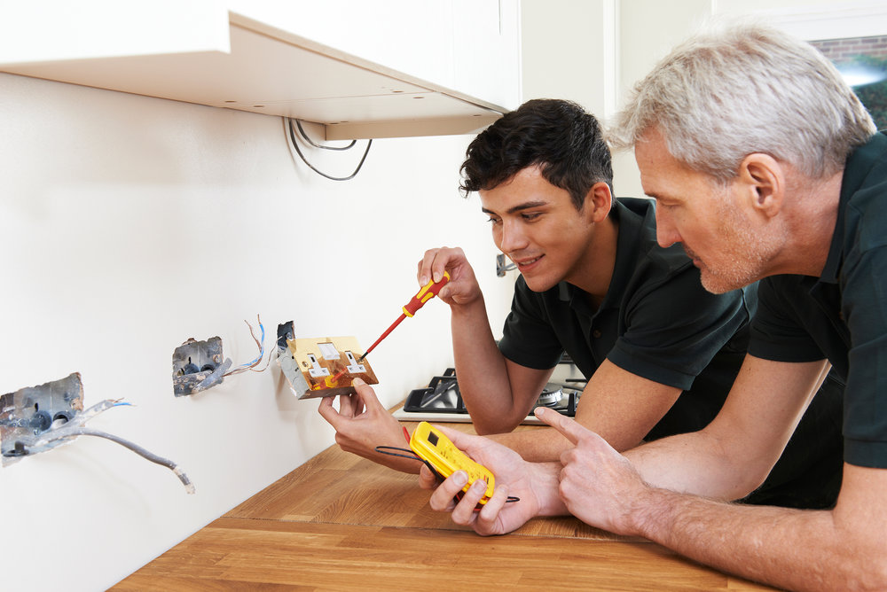 bigstock-Electrician-With-Apprentice-Wo-114109763.jpg