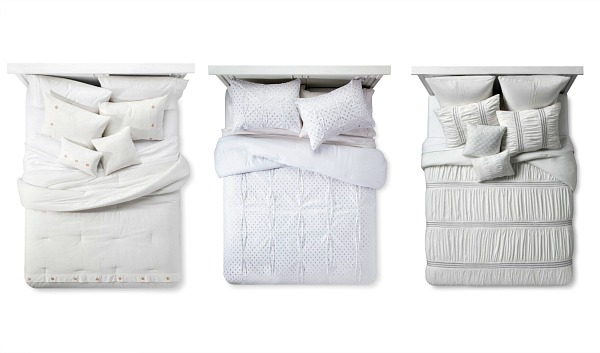 From right to left:   Odette 8pc. Comforter Set, $79.99  ;   Xhiliration White Gold Comforter Set ,  $49.99,   White Bailey Cotton Seersucker 5pc Comforter Set, $99.99