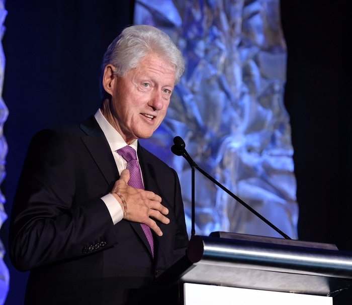 "President Clinton addresses the Rx Summit on April 4, telling the audience, ""A lot of you deserve medals for all the lives you saved and all the ones you will save."""