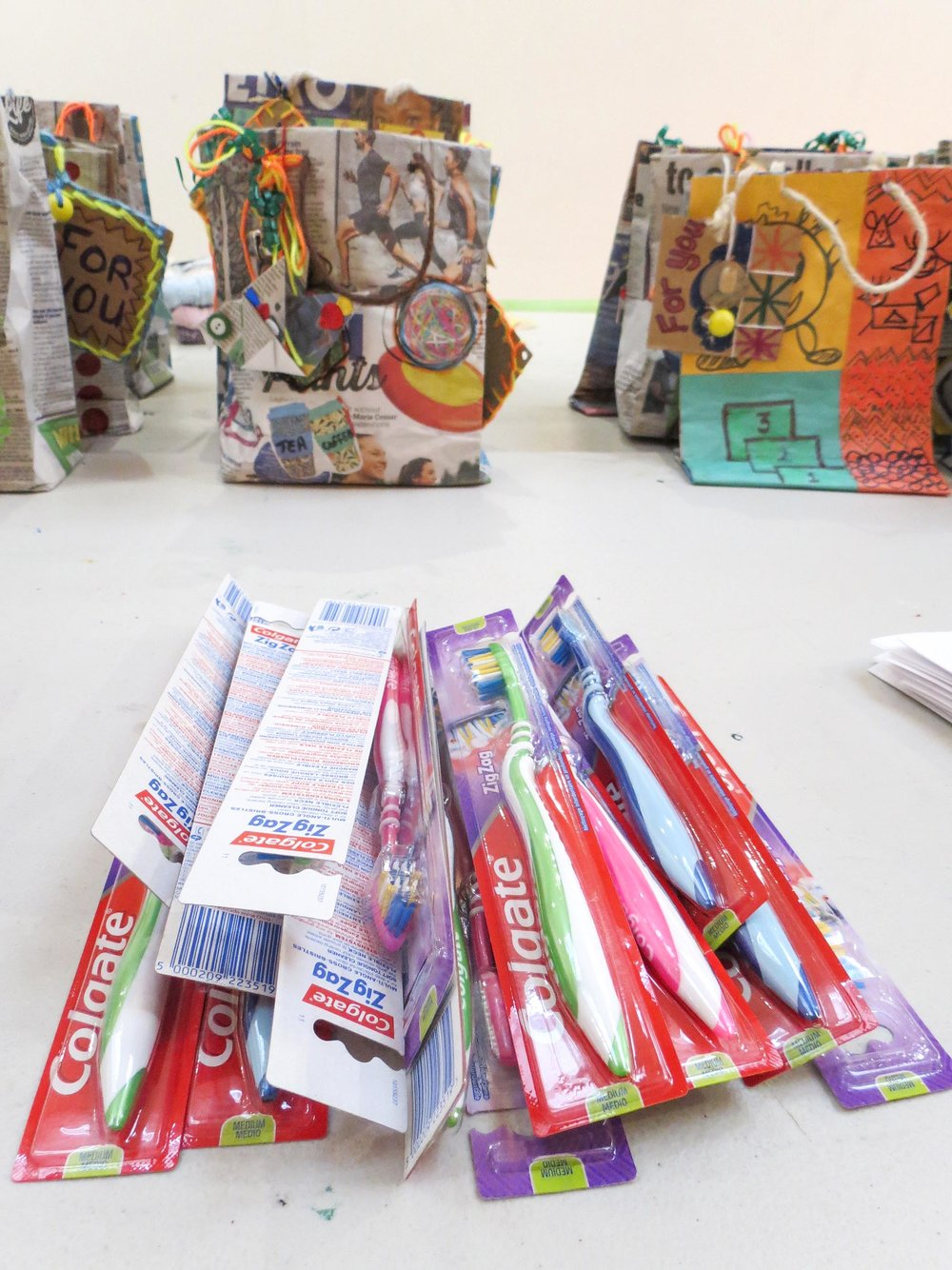 Positive Collective: Newspaper bags & gifts for local winter crisis centre