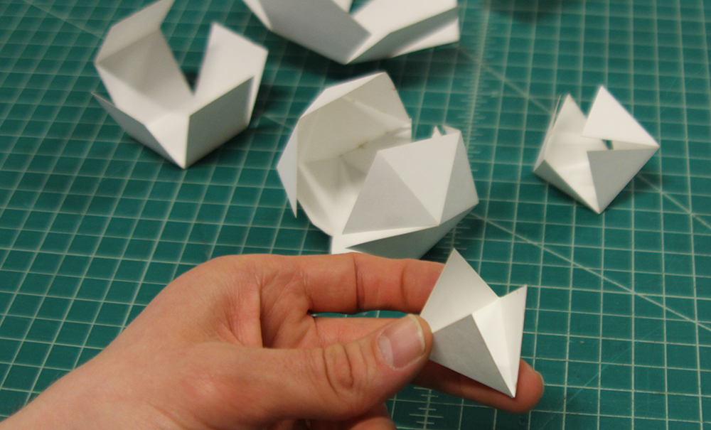 Laser cut platonic solids, folding in process.