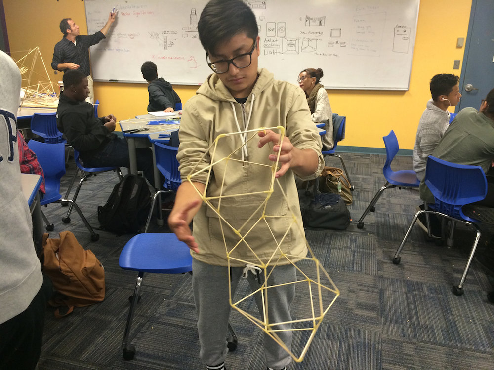 Student exploring tensegrity and a tesseract (time portal) in math class at Boston Arts Academy. Photo courtesy of Nettrice Gaskins.