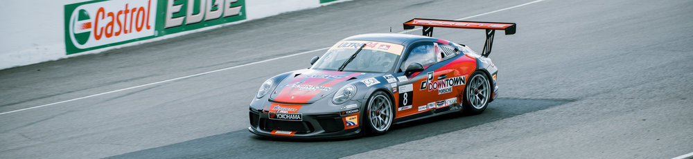 Porsche car driving on track for race