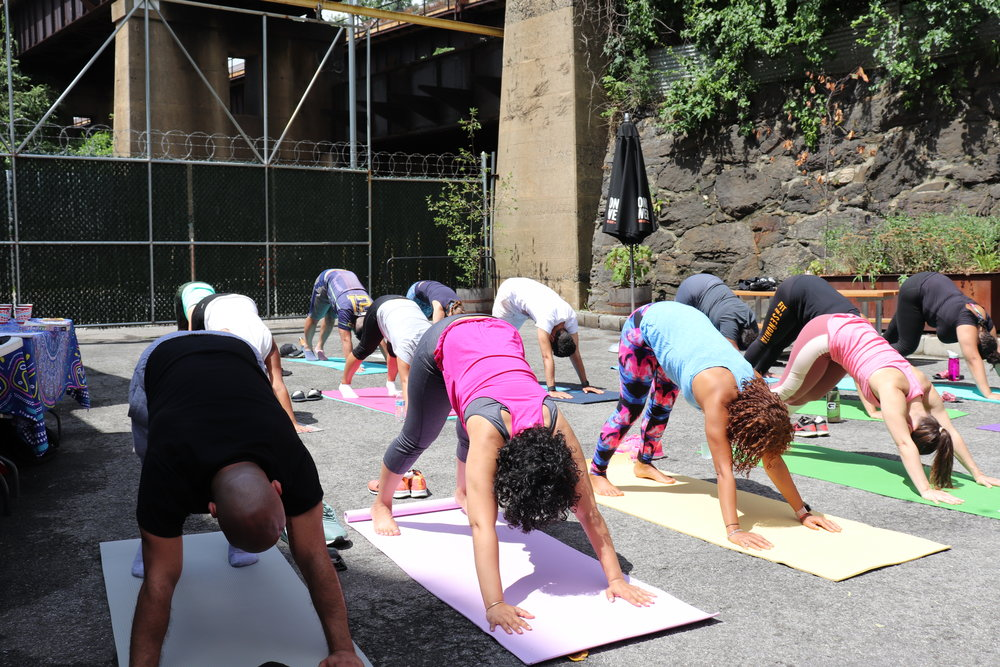 Opening up our shoulders in Downward Facing Dog