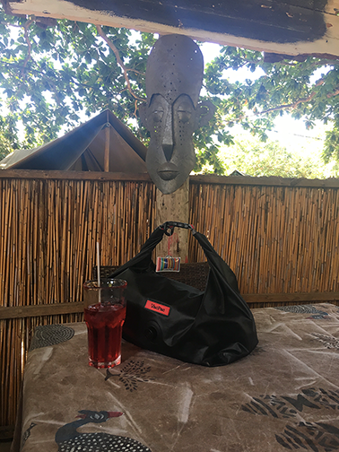 Waiting for check-in with an R&R. That's rum & raspberry in Ponta de Ouro, Mozambique! 🍹
