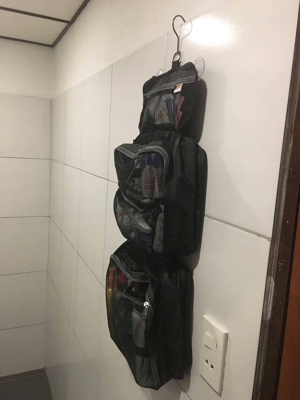 Can your toiletry bag do this in a bathroom like this, with nothing but a shower and a sink? Our HangPac can, hooked on comfortably & we haven't showed you our super strong suction cups yet!
