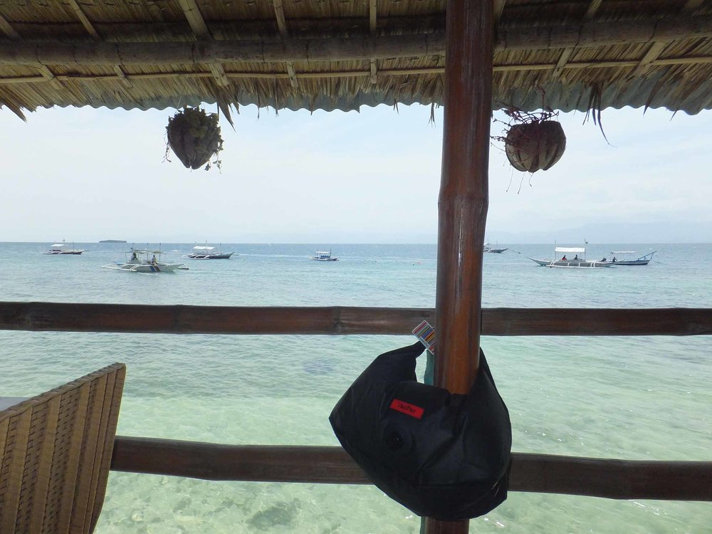It is practical to keep your money, mobile & towel clean & dry while enjoying lunch somewhere like this sun-drenched location of Moalboal in the Philippines! It's just a VacPac away!