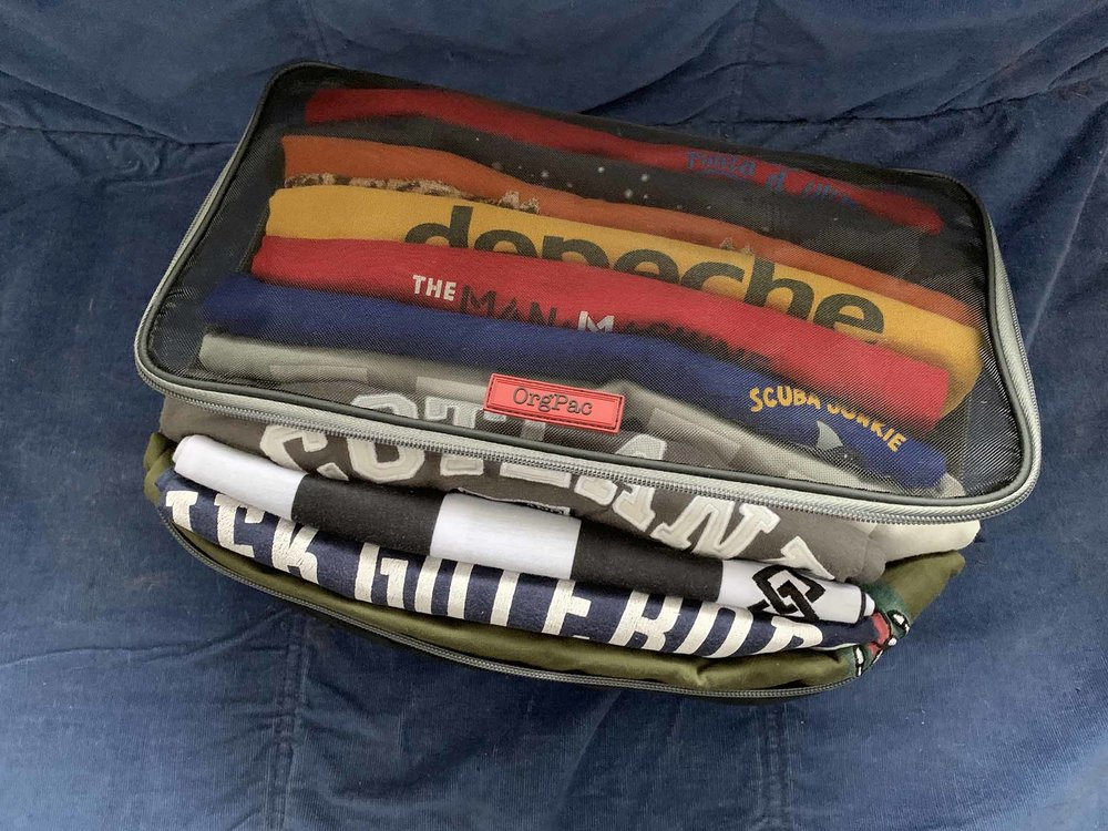 How many t-shirts can you stuff in an OrgPac? MANY! Easy access at the top and bottom. Practical, durable, stylish & luxurious! You can't go back to the usual cubes after using these!