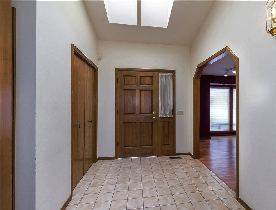 I love the skylights in the front entry and the vaulted ceiling.