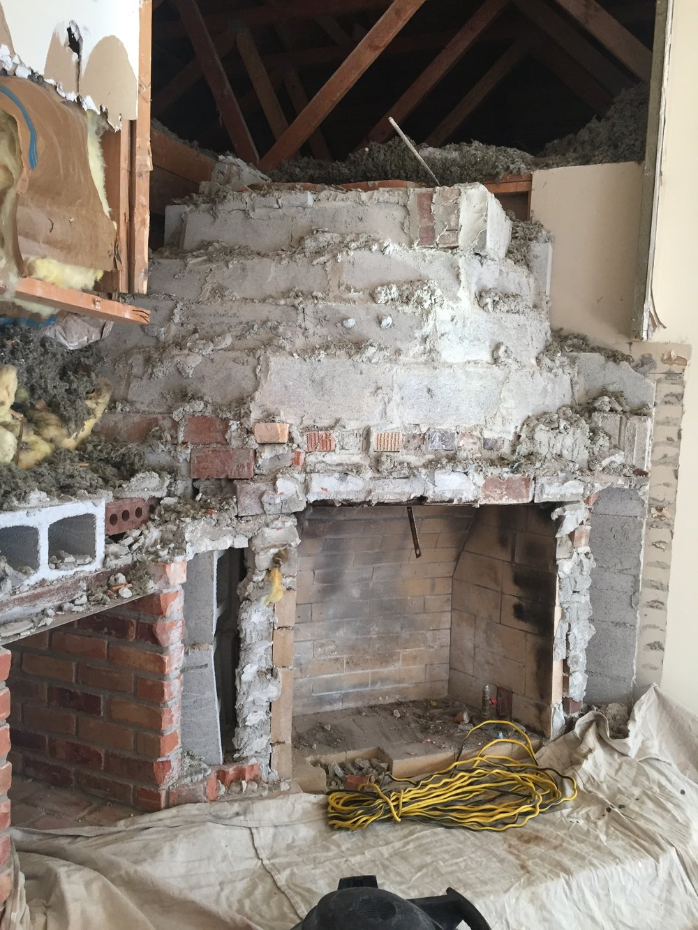 After taking it down more we decided to take out the whole thing! These fireplaces were a mess! So so much brick and concrete.