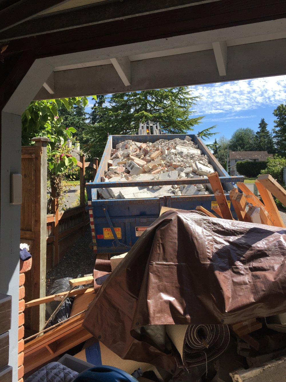 We will one whole dumpster just with brick and concrete from the fireplace!