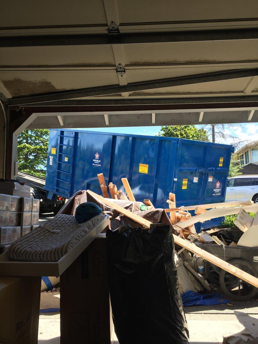 Our big huge dumpster being delivered