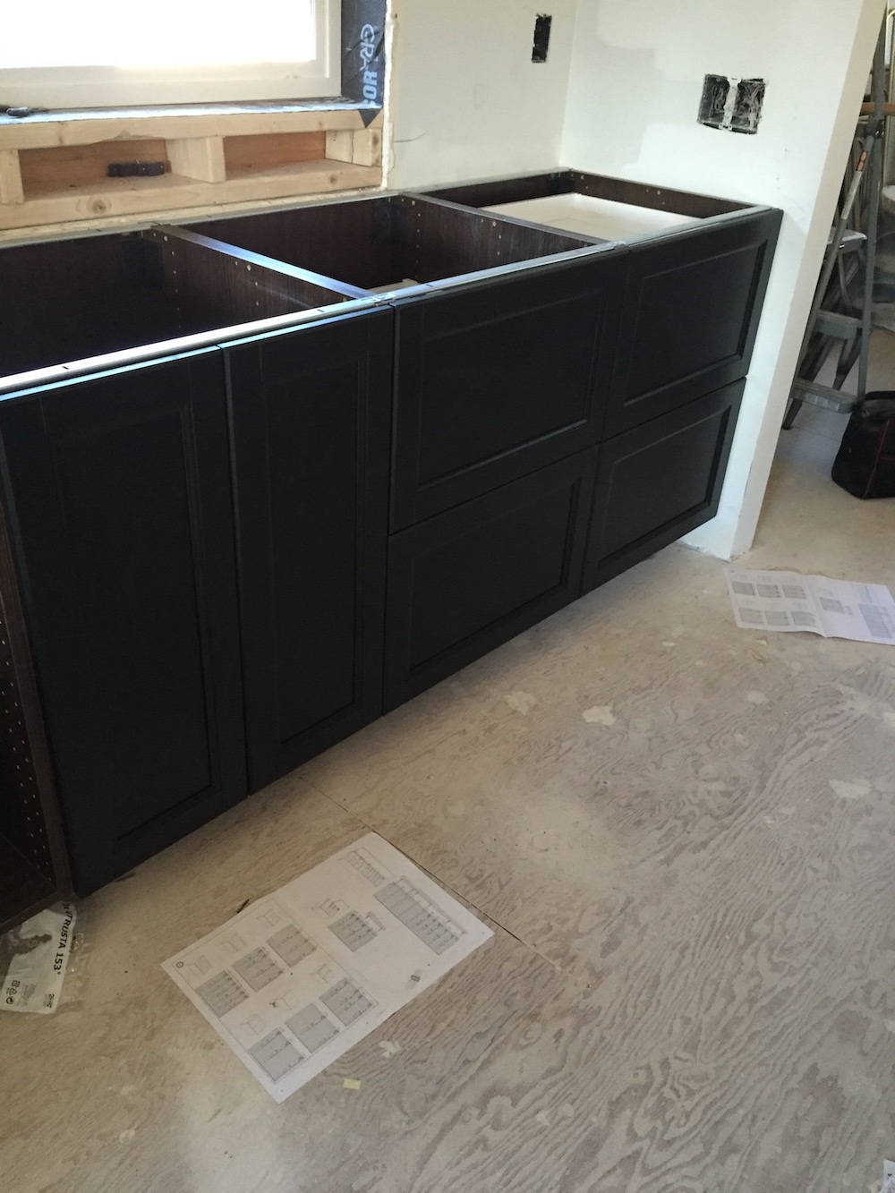 Ikea Laxarby Black/Brown Cabinet. I love them! They are solid wood fronts.