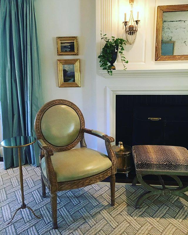 Living room vignette #citrusgreenleather #antiqueleopardbench #niermannweekssconces #bronzeurns #starkcarpet
