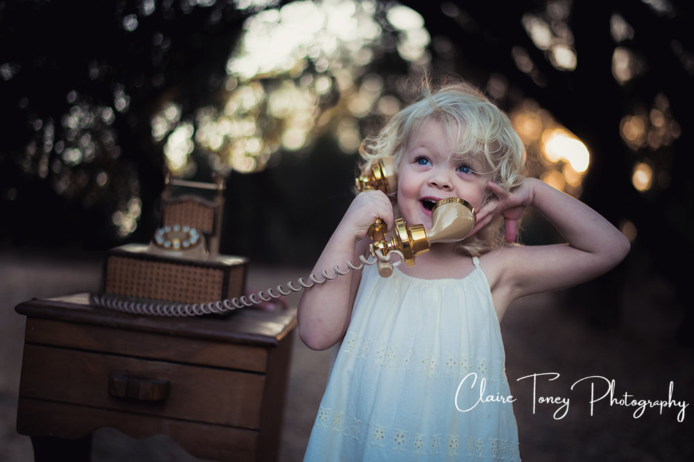 Little girl excitedly talking on a phone.jpg