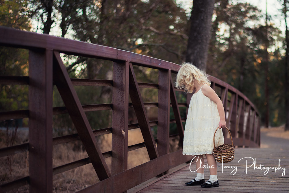 Little girl in a white dress on a bridge0155-2.jpg