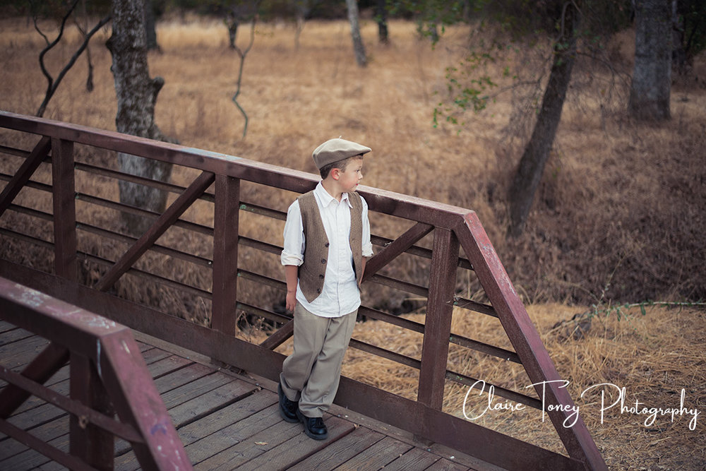 Boy in vest on a bridge 0242.jpg