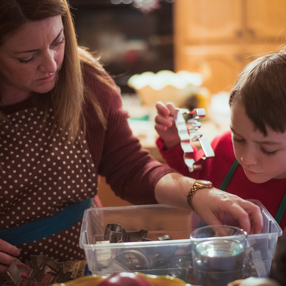 Mom and son looking through cookie cutter box