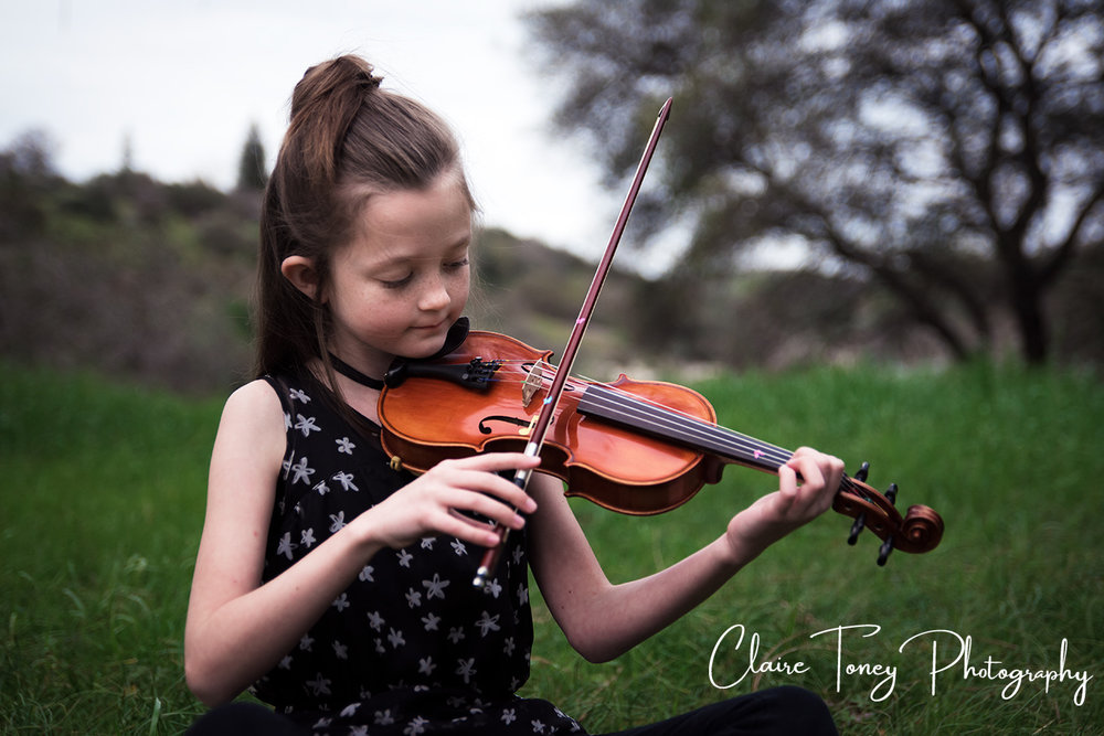 Tween girl playing a violin