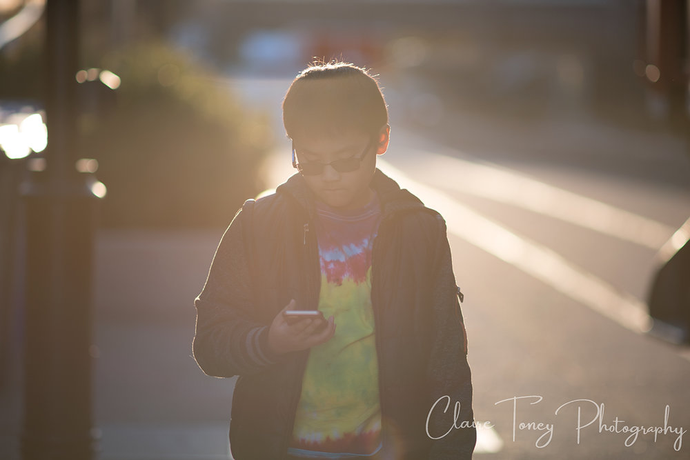 hazy photo of a boy holding  aphone
