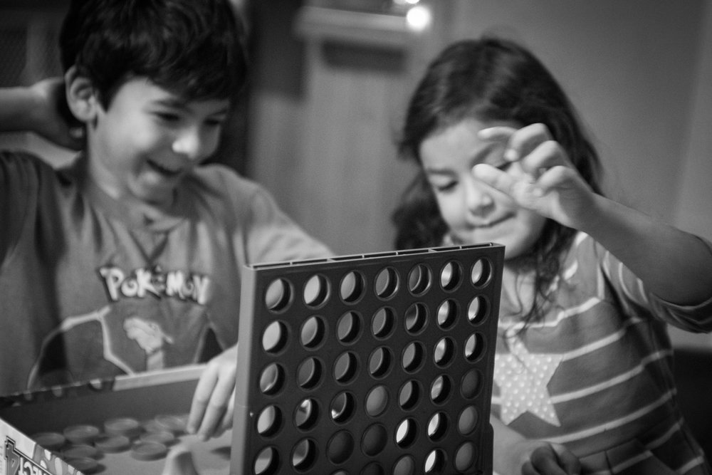 Brother and sister playing Connect Four