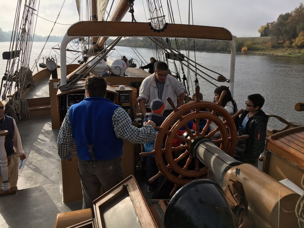 Children learning about navigation on board the Hawaiian Chieftain