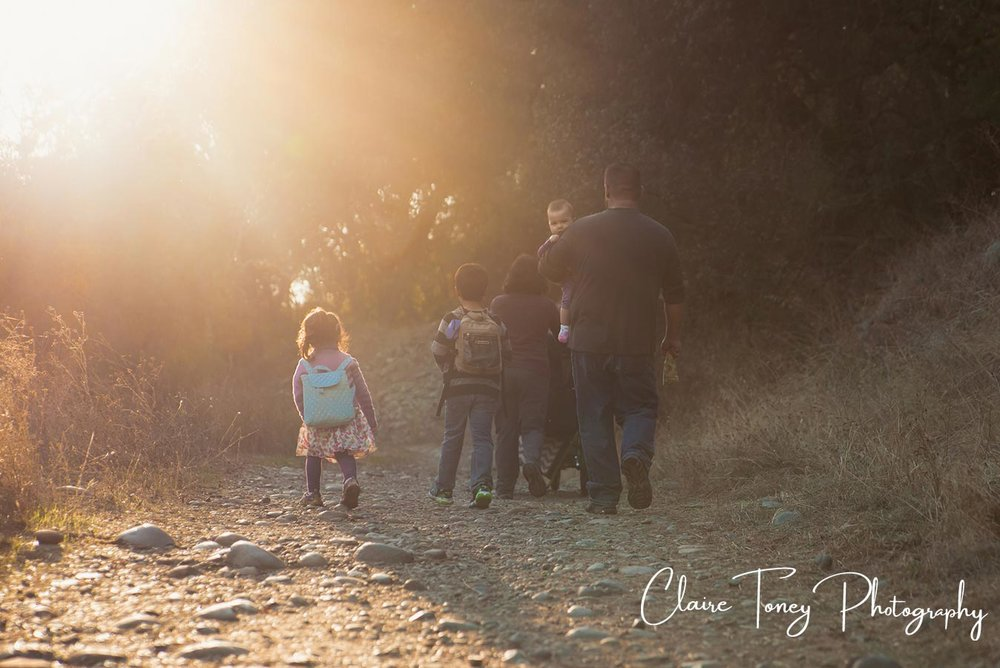 Family hike on the American River Parkway during sunset