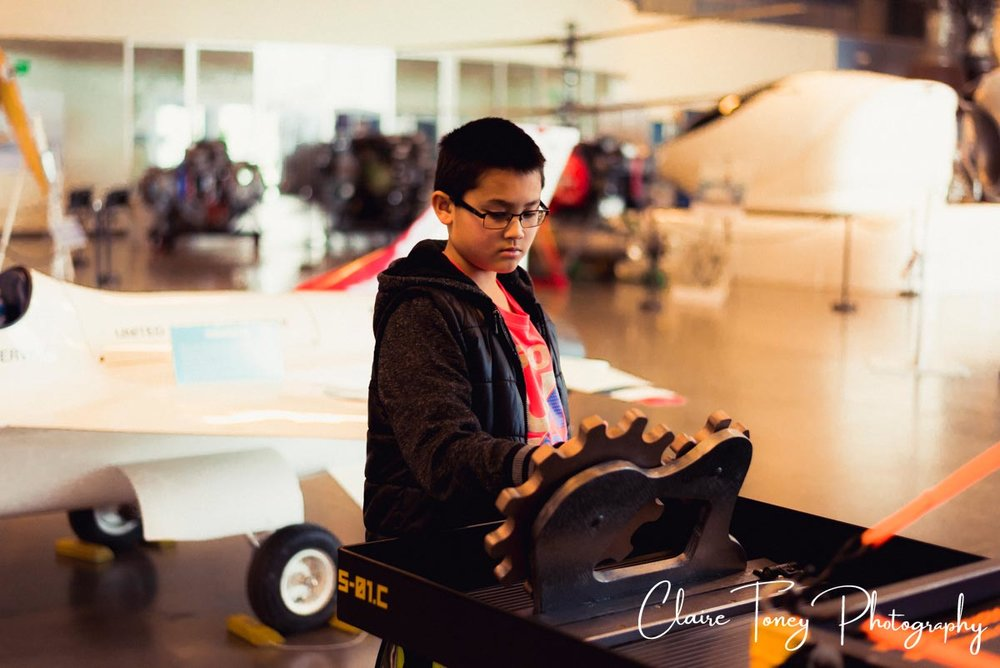 Boy playing with gears at the Aerospace Museum of California, Sacramento