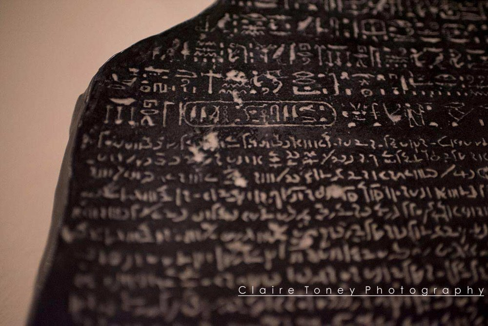 Detail of Rosetta Stone. Photo taken by Claire Toney at the Rosicrucian Museum