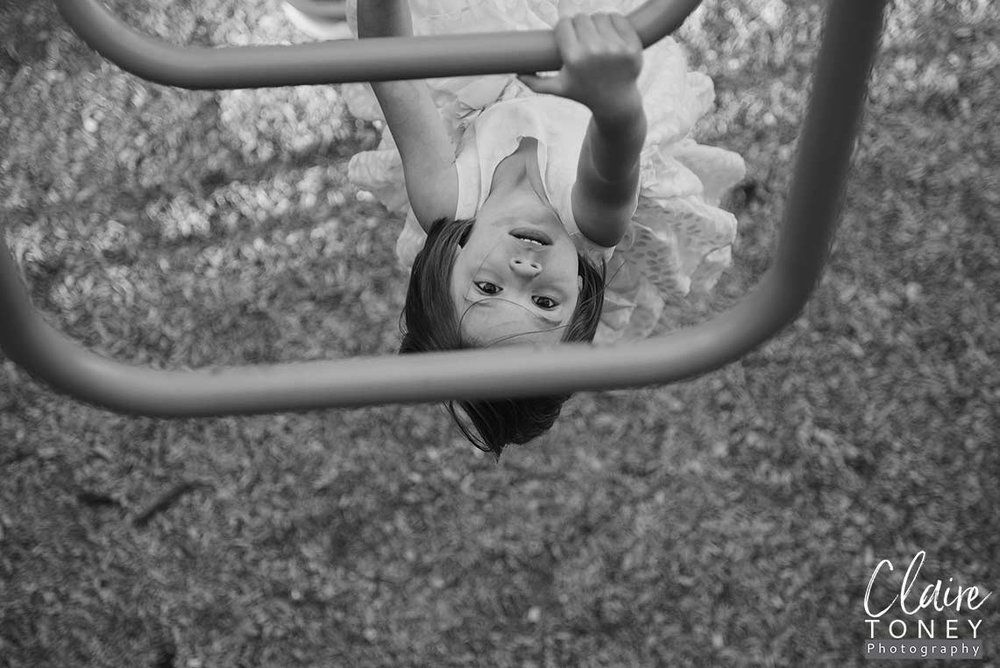 High view of a girl climbing the monkey bars