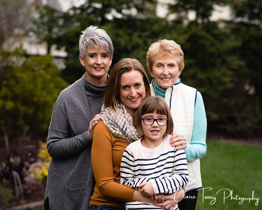 Four generation portrait with young girl, her mother, grandmother, and great grandmother