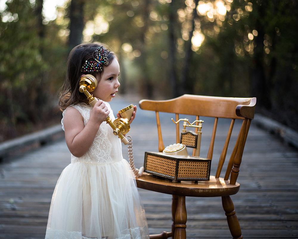 Little girl talking on a vintage phone