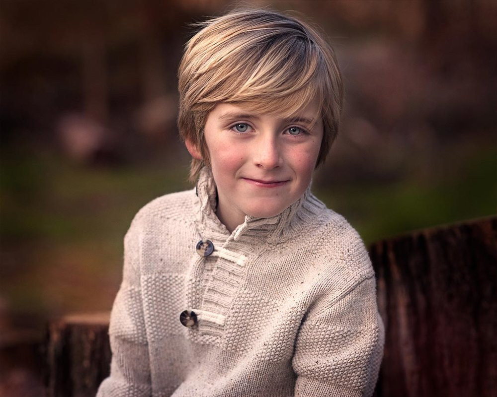 Young blonde boy wearing a cream colored sweater in Folsom CA