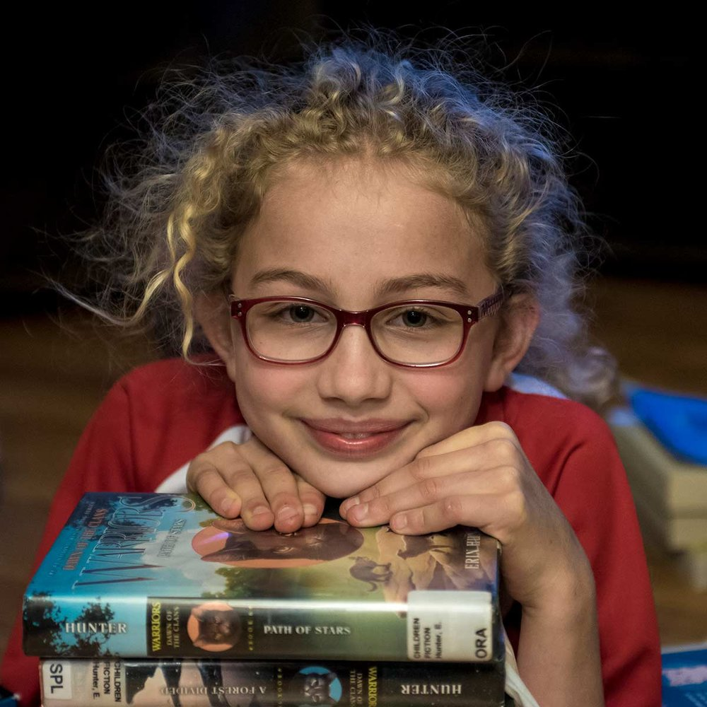 tween-resting-on-books-child-photography.jpg