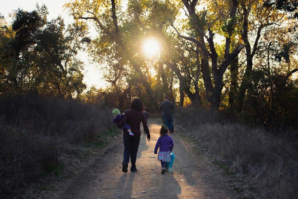 A family hiking in Fair Oaks CA before sunset