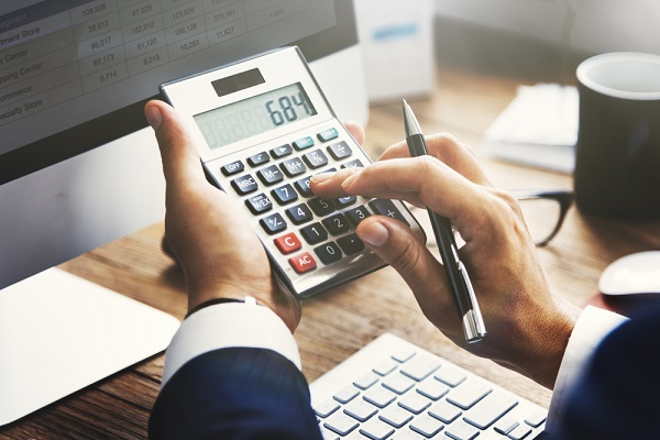 A man holding a calculator