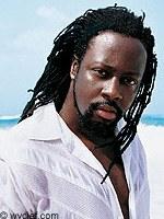 77_0_Wyclef_Jean_Adopts_a_Haitian__H040050_L