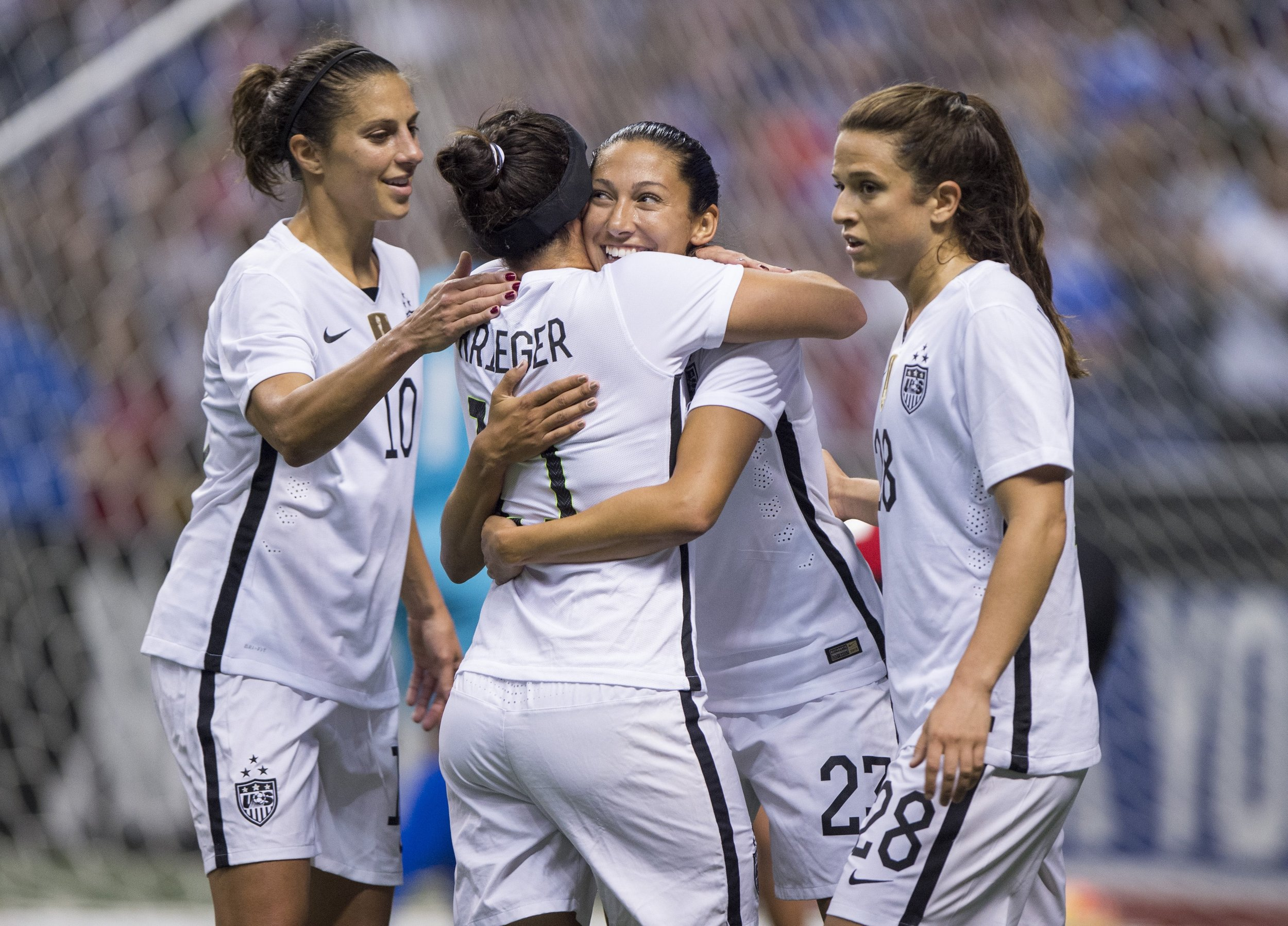 Christen Press, Ali Krieger-- San Antonio, TX - December 10, 2015:  The USWNT defeated Trinidad & Tobago 6-0 during the Victory Tour at the Alamodome. Photo by Brad Smith