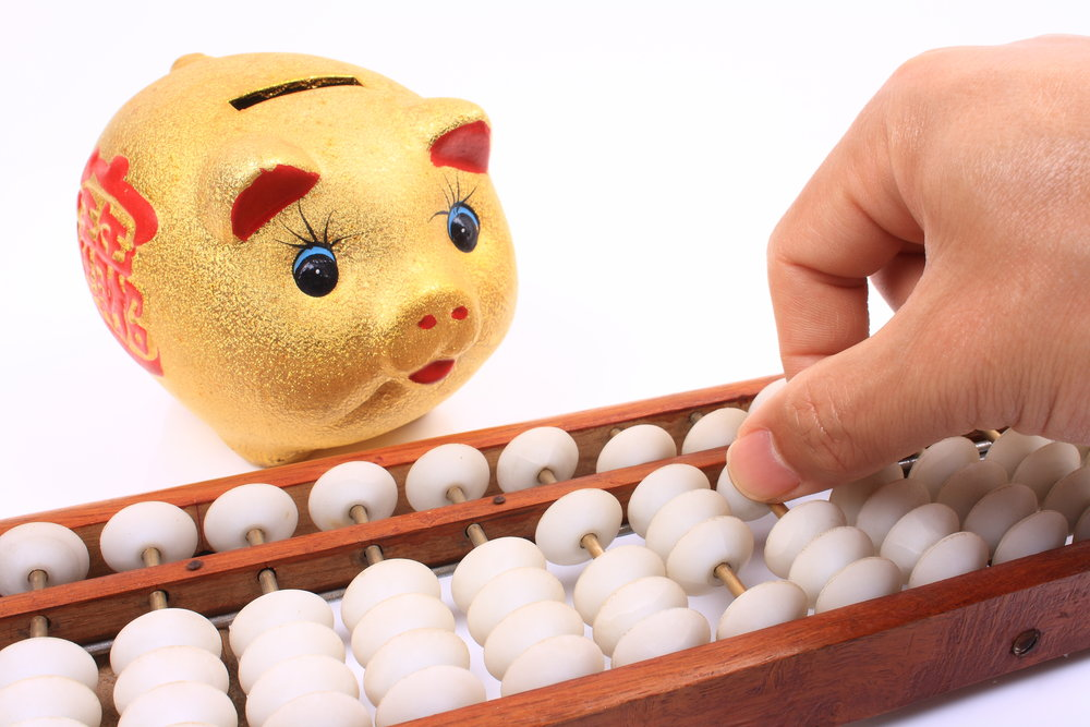 iStock-493833787 Abacus and piggy bank.jpg