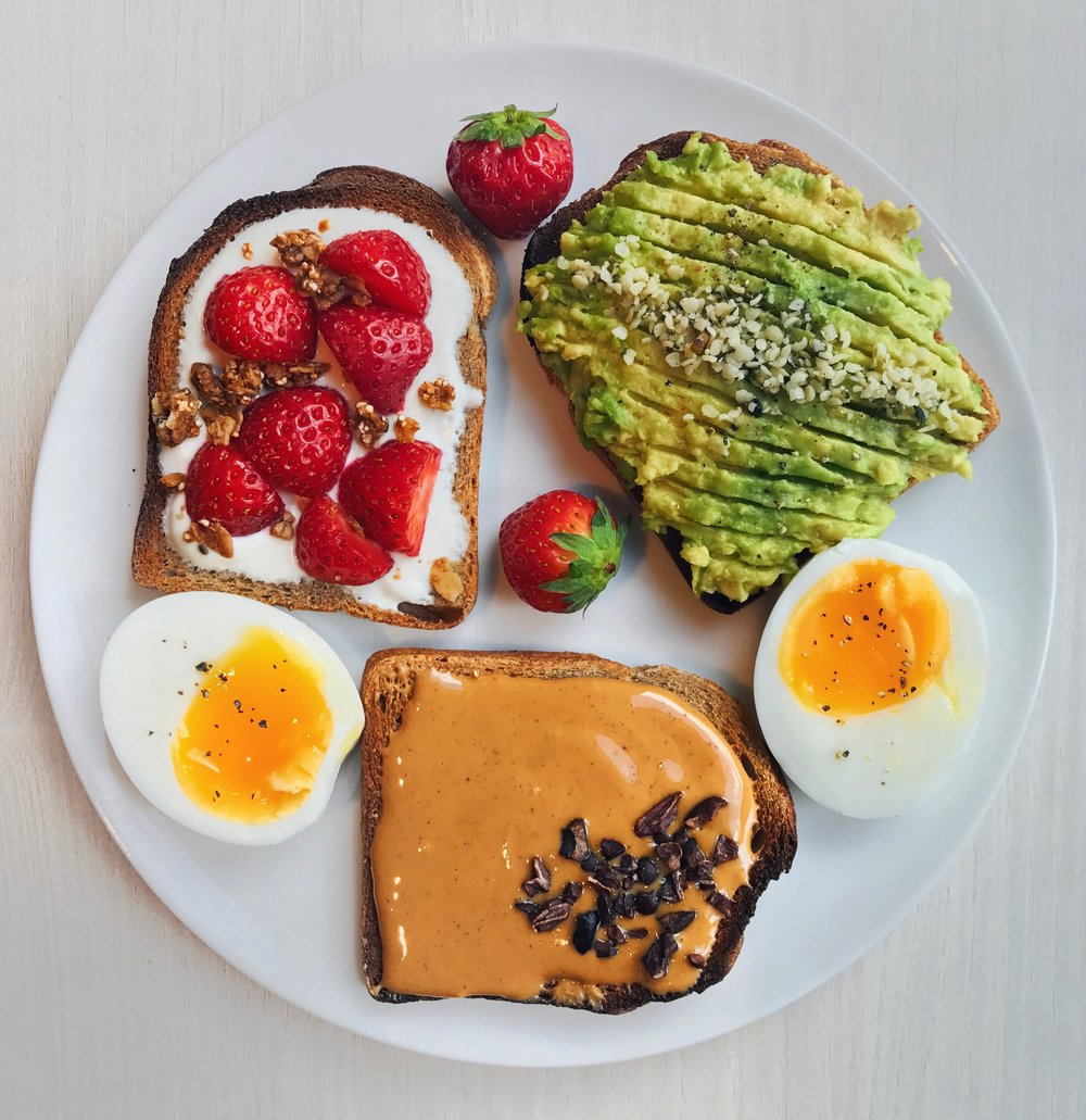 Avocado, Peanut Butter & Greek Yogurt + Strawberry Toasts - Toasted small wholewheat bread topped with 1) @naturalia_magasins_biomashed avocado + @forceultranaturehemp seeds, 2) @crazyrichardspb peanut butter + @navitasorganics cacao nibs and 3) greek yogurt + vanilla + @driscollsberrystrawberries + @purely_elizabeth granola as well as a soft-boiled egg + black pepper